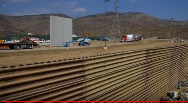 Prototype for Donald Trump's border wall under construction. [Image source/The Telegraph YouTube video]