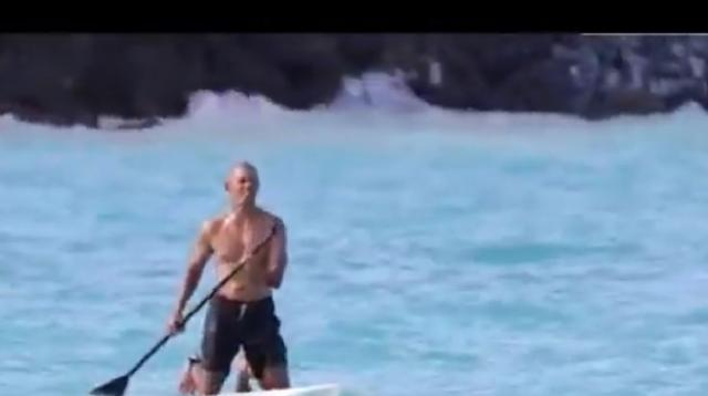 Shirtless Barack Obama Video paddleboarding in Hawaii. [Image source/Mary Abolade YouTube video]