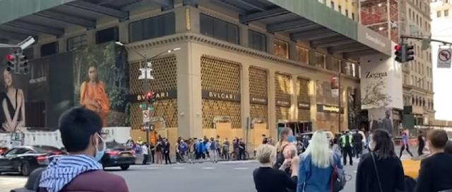 Crowds gather at Trump Tower to celebrate Joe Biden victory. [Image source/Bloomberg Quick Take: Now YouTube video]