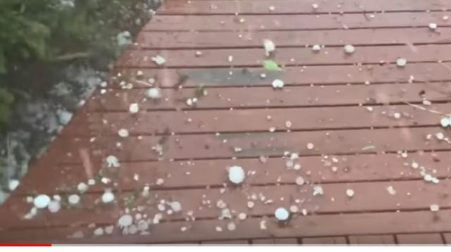 Huge hail batters Canberra as storms threaten large areas of Australia. [Image source/Guardian News YouTube video]