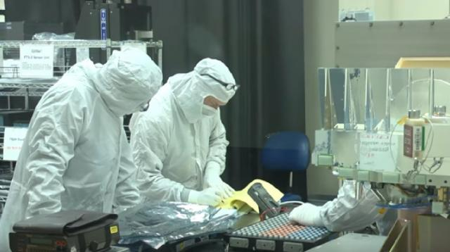 Scientists work on NASA CubeSats - satellite small enough to fit in your hand. [Image source/NASAeClips YouTube video]