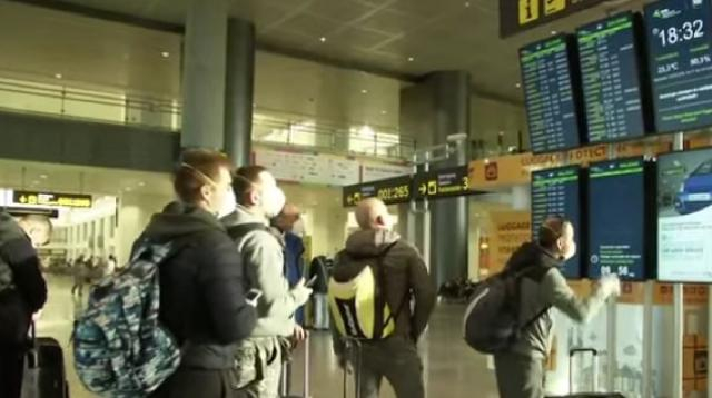 Foreign tourists leave Spain as coronavirus emergency declared. [Image source/AP Archive YouTube video]