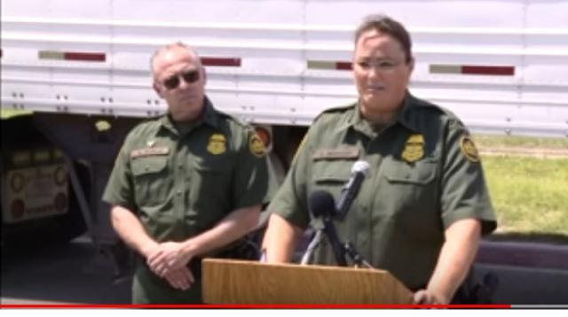 86 migrants found in tractor-trailer. [Image source/KENS 5 YouTube vide]