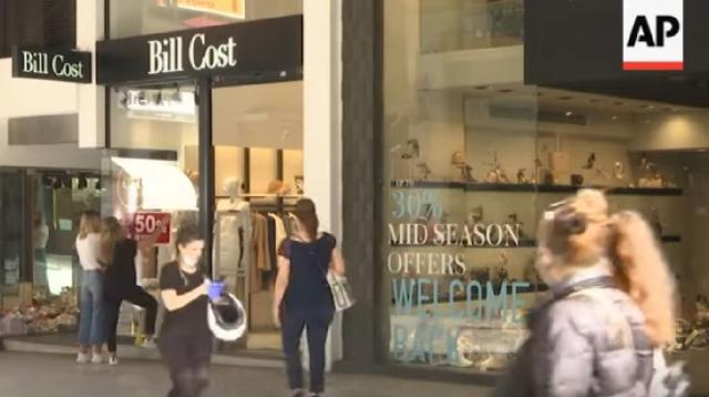 More retail stores in Greece now allowed to reopen. [Image source/AP Archive YouTube video]