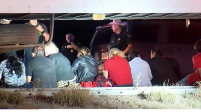 Tractor-trailer carrying more than 80 migrants stopped in South Texas. [Image source/KSAT 12 YouTube vide]