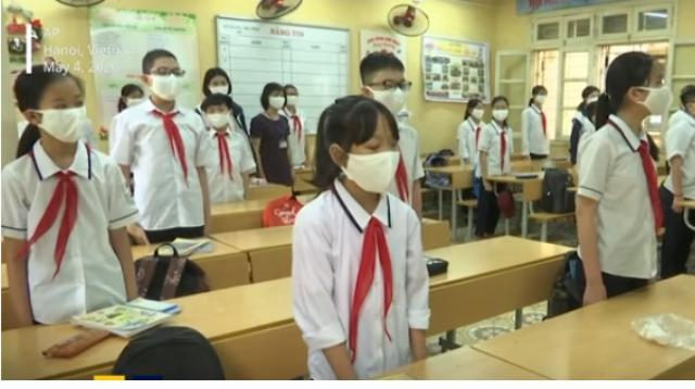 Vietnam children return to class after three-month closure for COVID-19 lockdown. [Image source/South China Morning Post YouTube video]