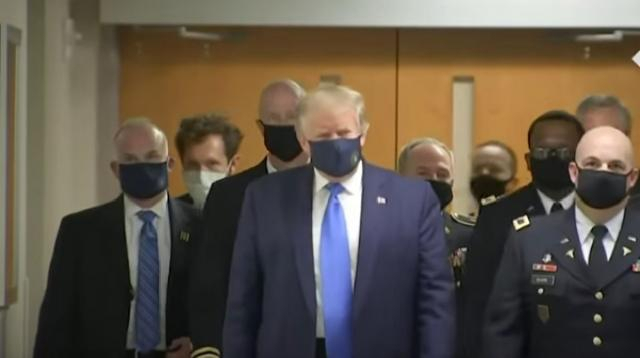 Donald Trump wears face mask in public for first time. [Image source/The Telegraph YouTube video]