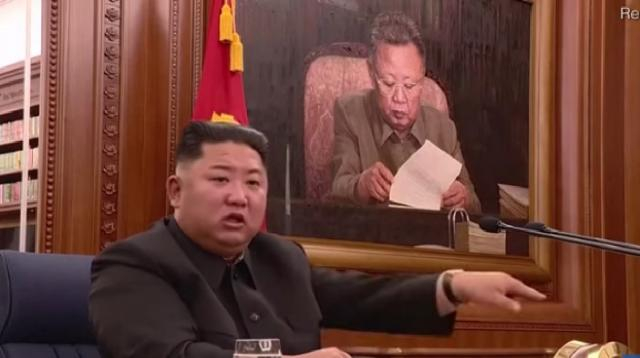 Kim Jong-un, leader of North Korea, holds meeting with military heads. [Image source/Daily Mail YouTube video]