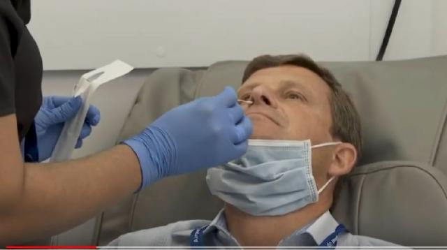Coronavirus testing site opens for airport and airline staff at JFK airport. [Image source/AFP News Agency YouTube video]