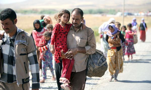 Migranti yazidi liberi da Daesh.